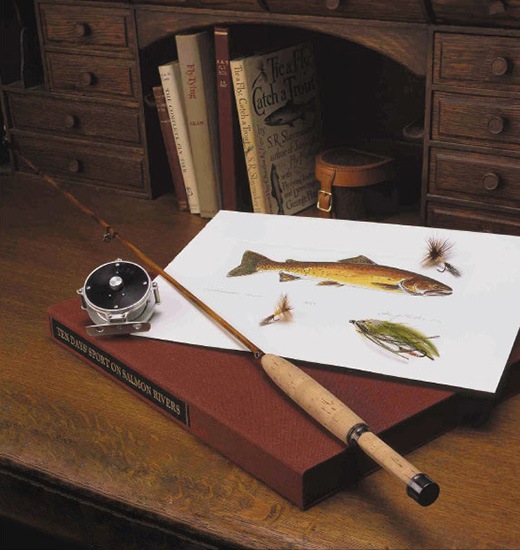 angling equipment on a desk with angling books