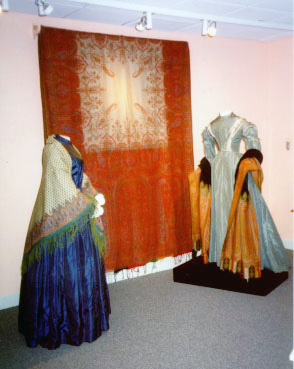 Two dresses and a paisley shawl