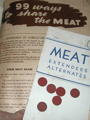 Meat ration tokens with WWII era pamphlets