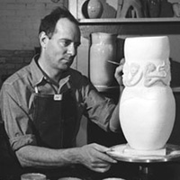 Ed Scheier looks upon his work