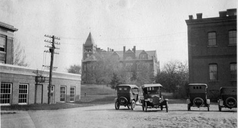 Cars parked in Conant Hall Courtyard, 1924