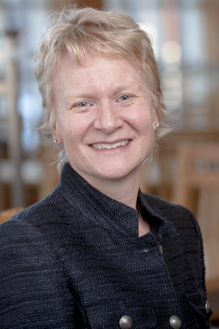 portrait photo of Jennifer Carroll smiling